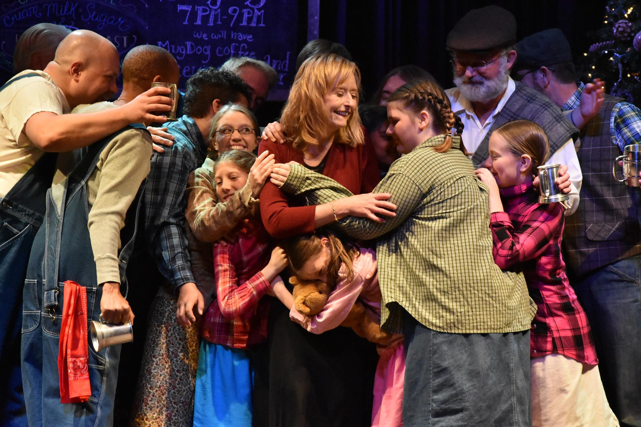 Townsfolk hug Sarah Cannon in Heart of the Holidays 2017